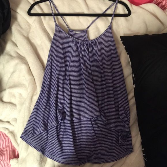Purple striped tank Cute high low purple striped tank! Worn a few times! Size medium but unfortunately I cut the tag out because it itched! Brand is full tilt purchased at Tillys Full Tilt Tops Tank Tops