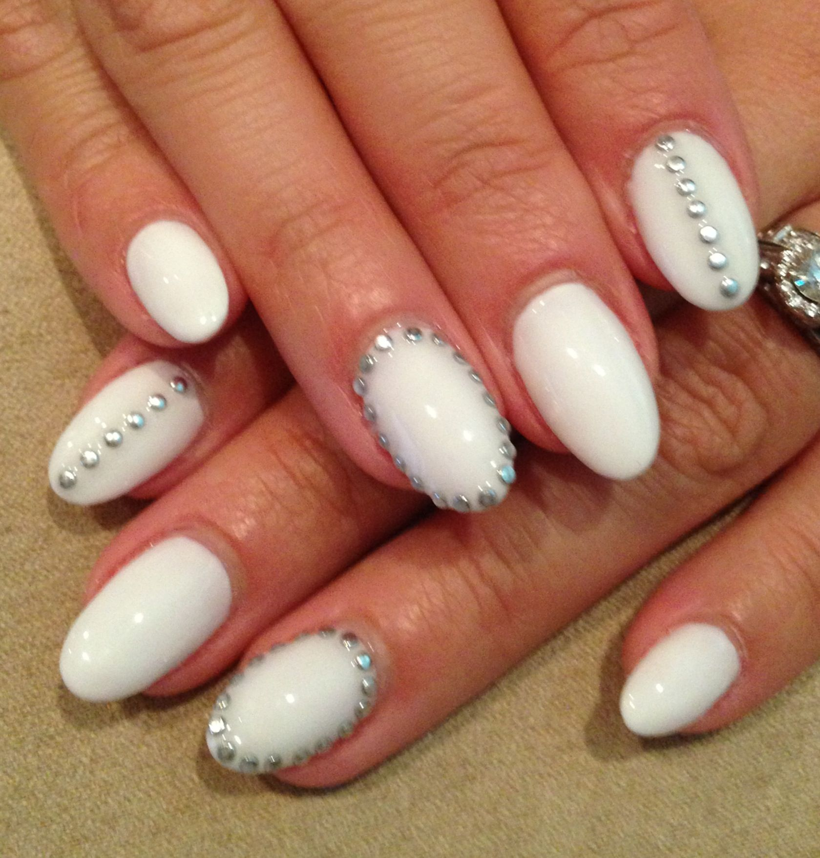 White with studs. Really like the almond nail shape on this mani ...