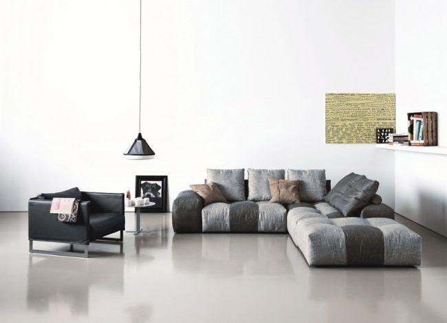 Sofa-Grau-Pendelleuchte-Ledersessel-Wandkunst Canapé modulab