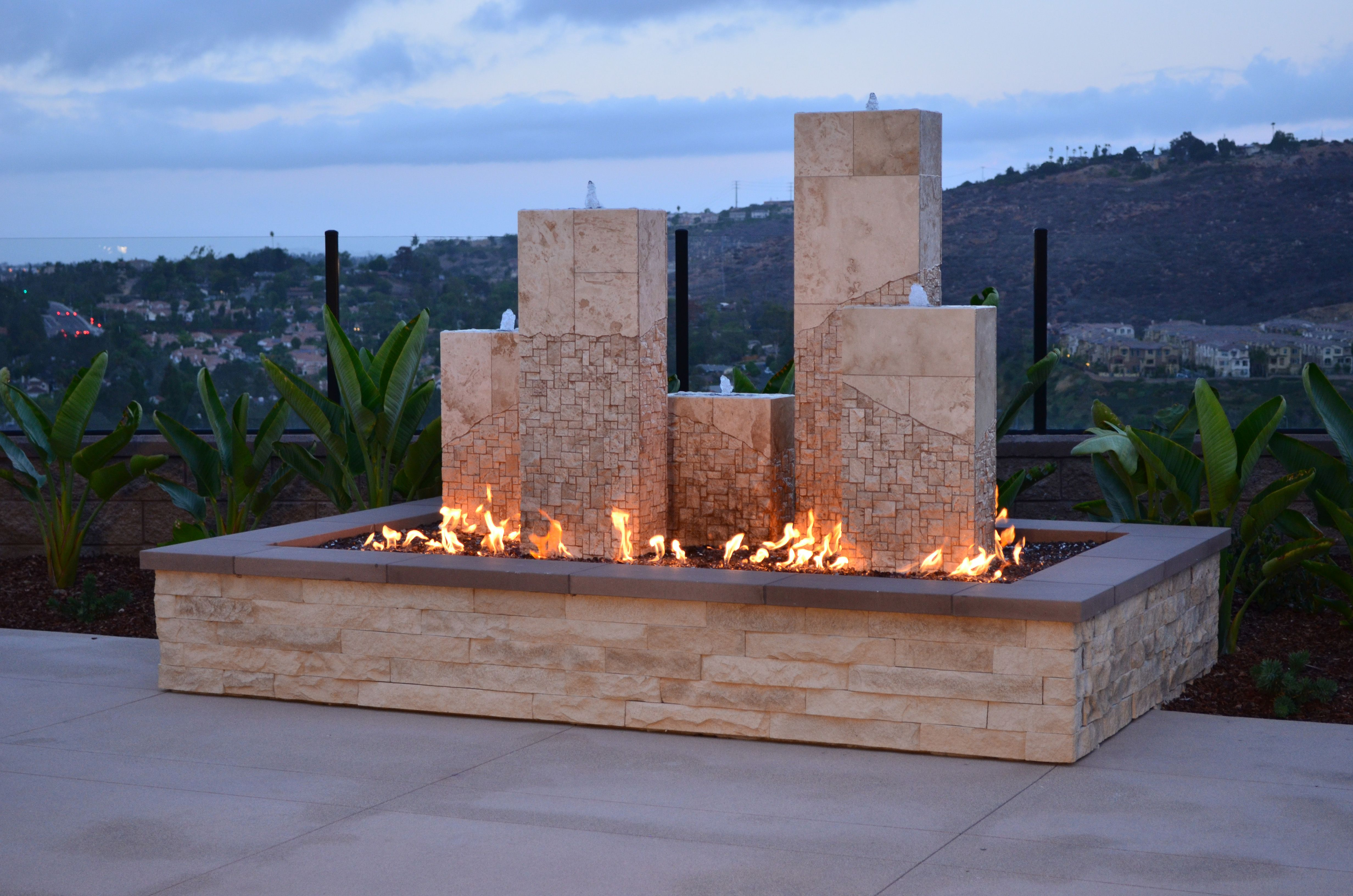 outdoor fireplace using travertine splitface series in beige by