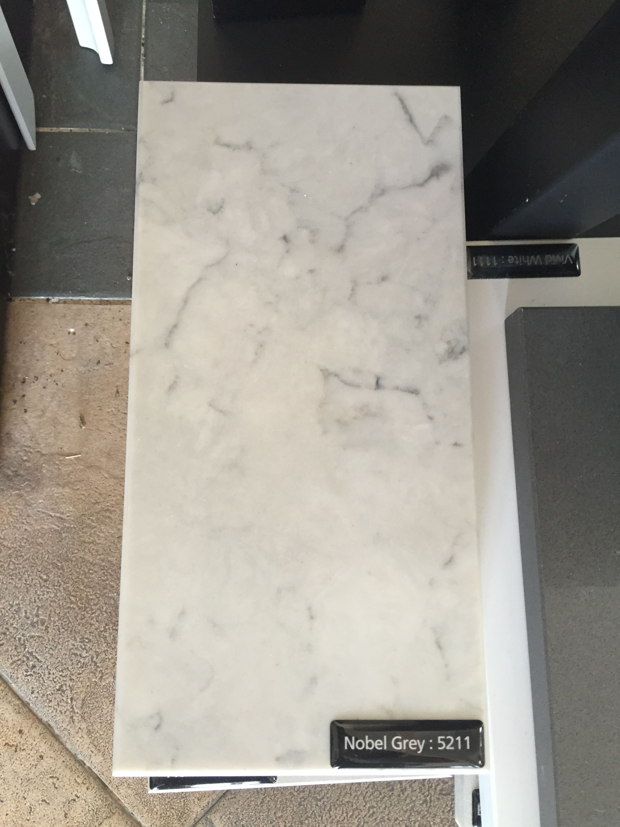 Caesarstone marble look alike countertop with potential although