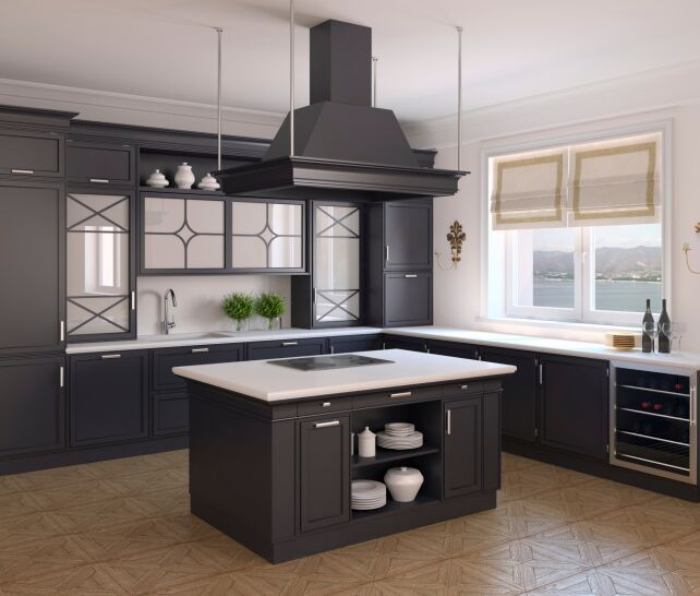 Clean lines and square designs cover the cabinetry in this black and white kitchen. Do you like the island in the center with a stove?