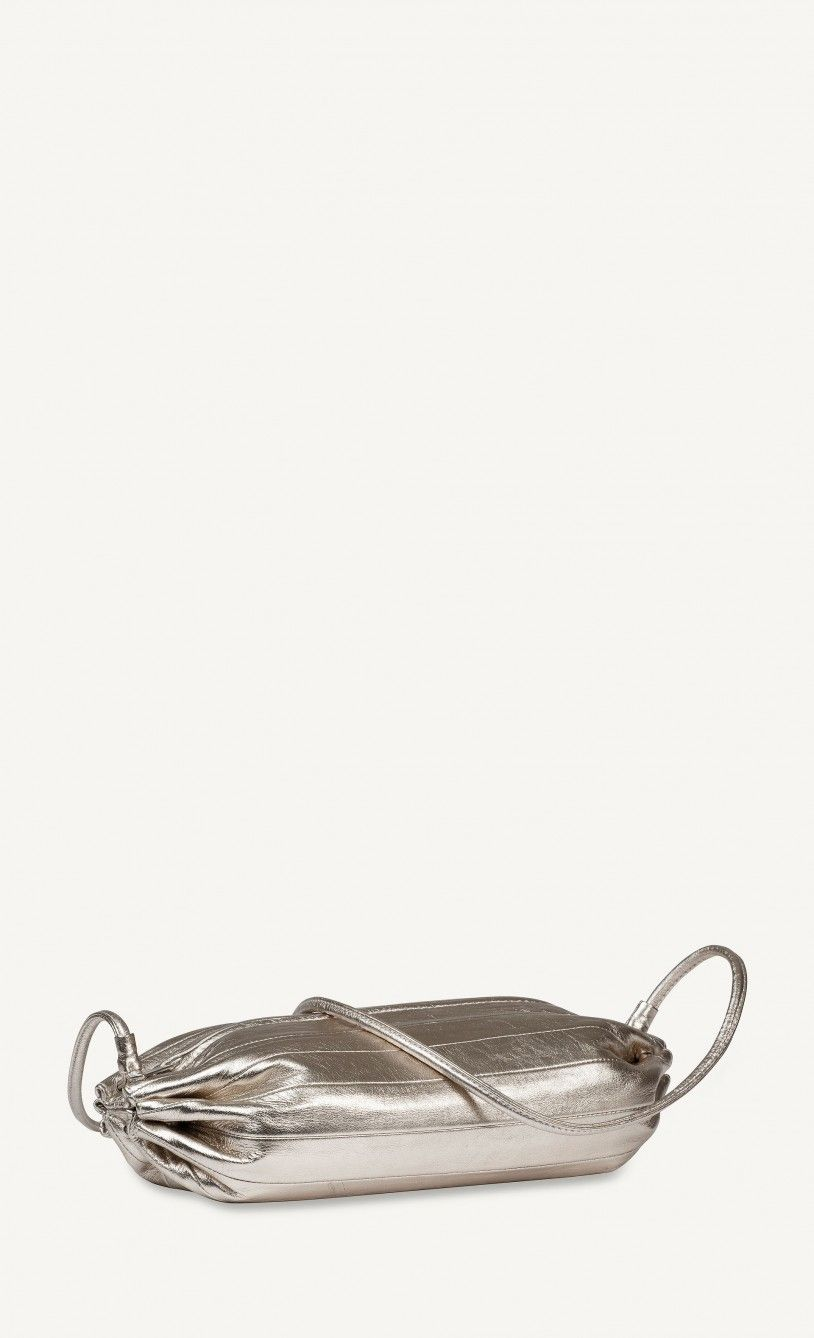 671406fb12d588 Shoulder/cross body bag KARLA in silver. Made of soft leather, design  inspired by a candy wrapper. Several other colours also available.