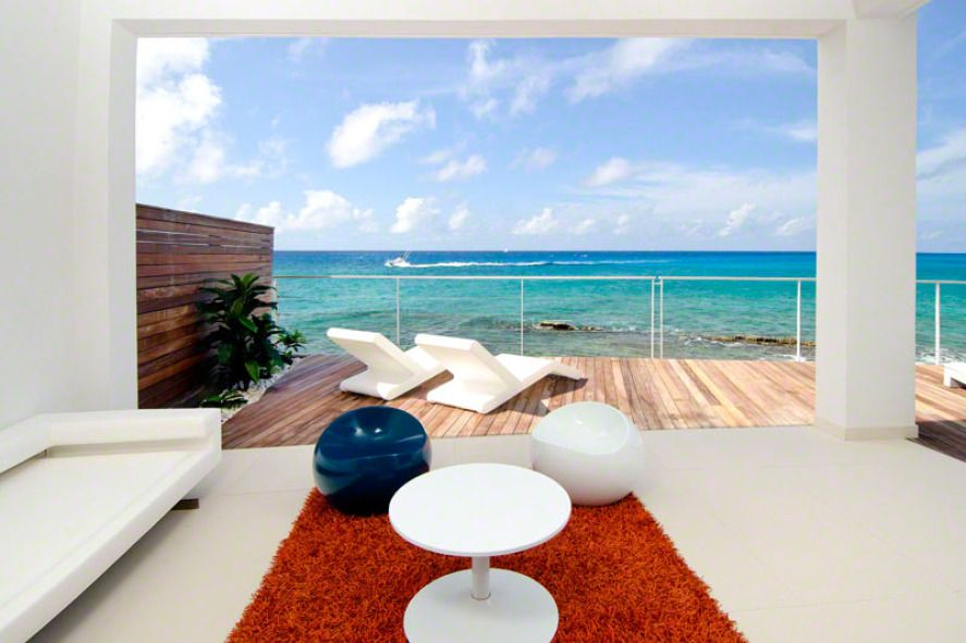 This 2 bedroom condo/villa is romantic and private yet only a short walk to the action on Simpson Bay Beach and a 2 minute drive to restaurants, clubs, and casinos in Maho.