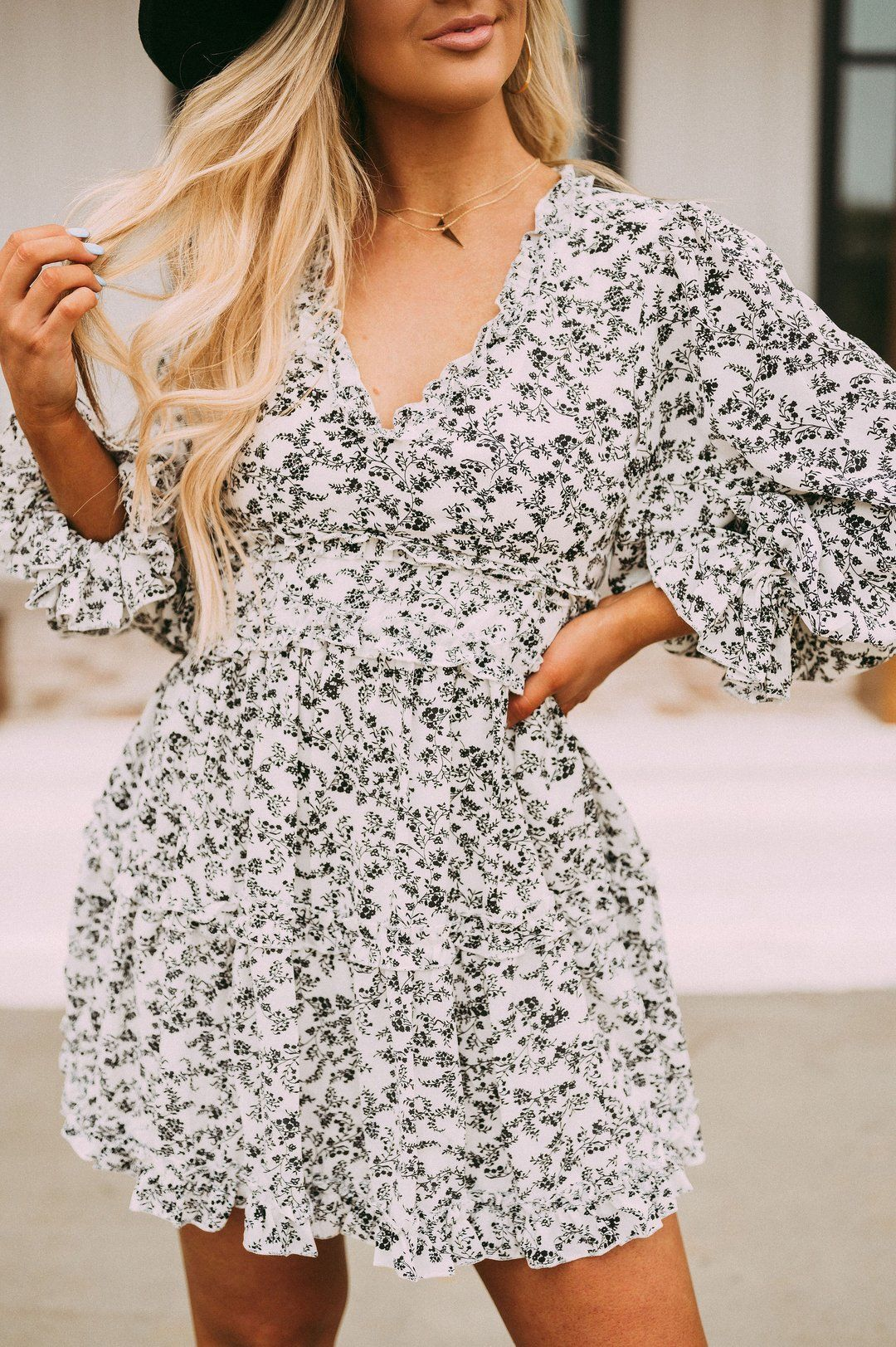 Black And White Floral Print Dress Featuring A V Neckline Ballon Sleeves A Ruffled Bottom Hem And An Ope White Floral Print Dress Dresses Floral Print Dress [ 1623 x 1080 Pixel ]