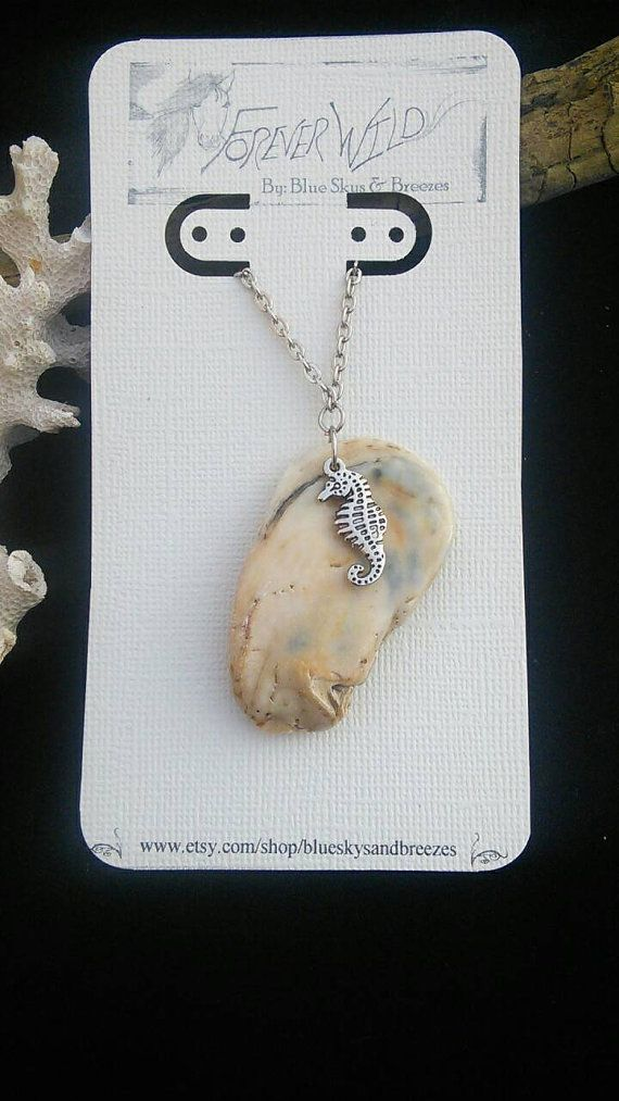 Check out this item in my Etsy shop https://www.etsy.com/listing/211921173/beautiful-shell-necklace-with-seahorse
