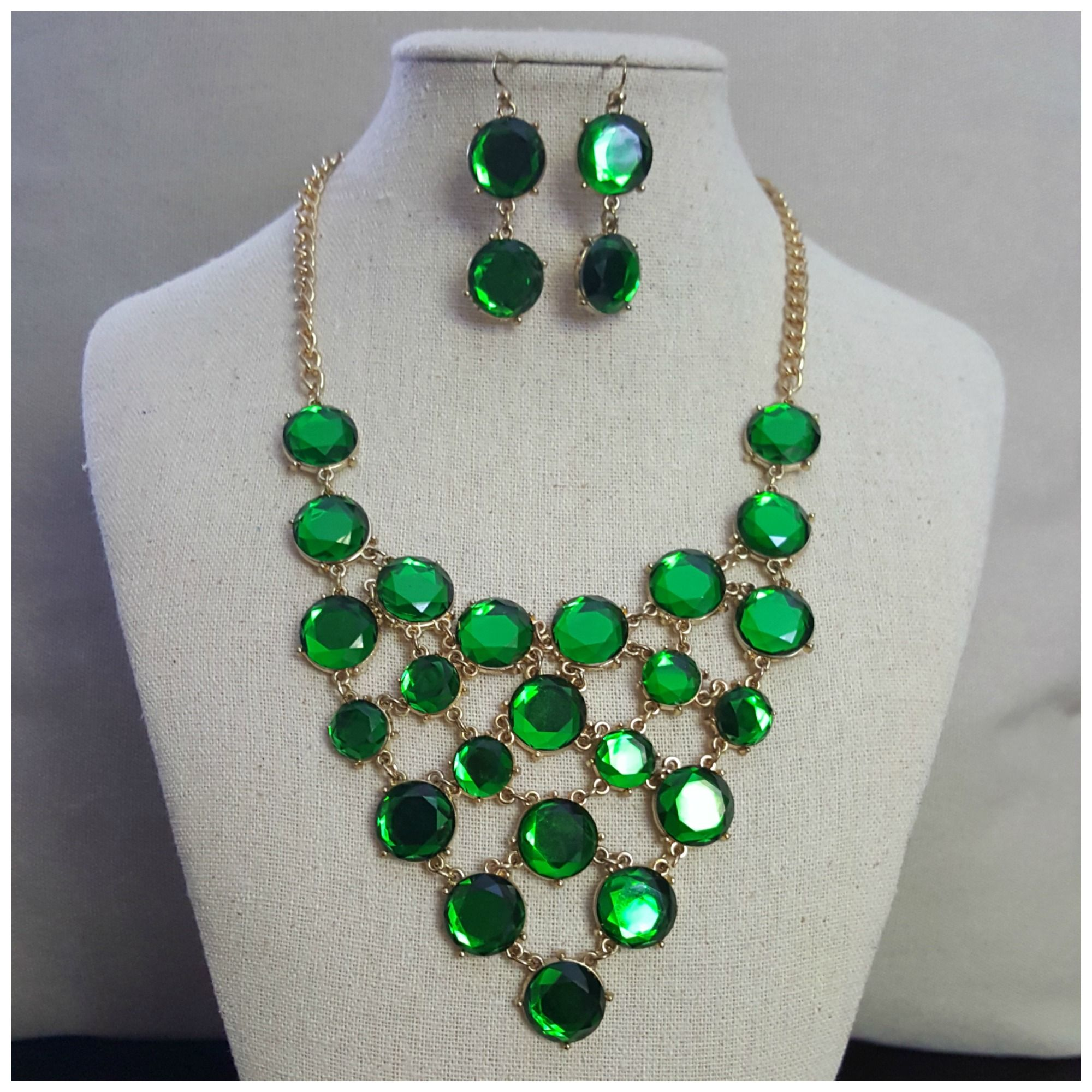 Vintage gold tone necklace and earring set with emerald gemstone