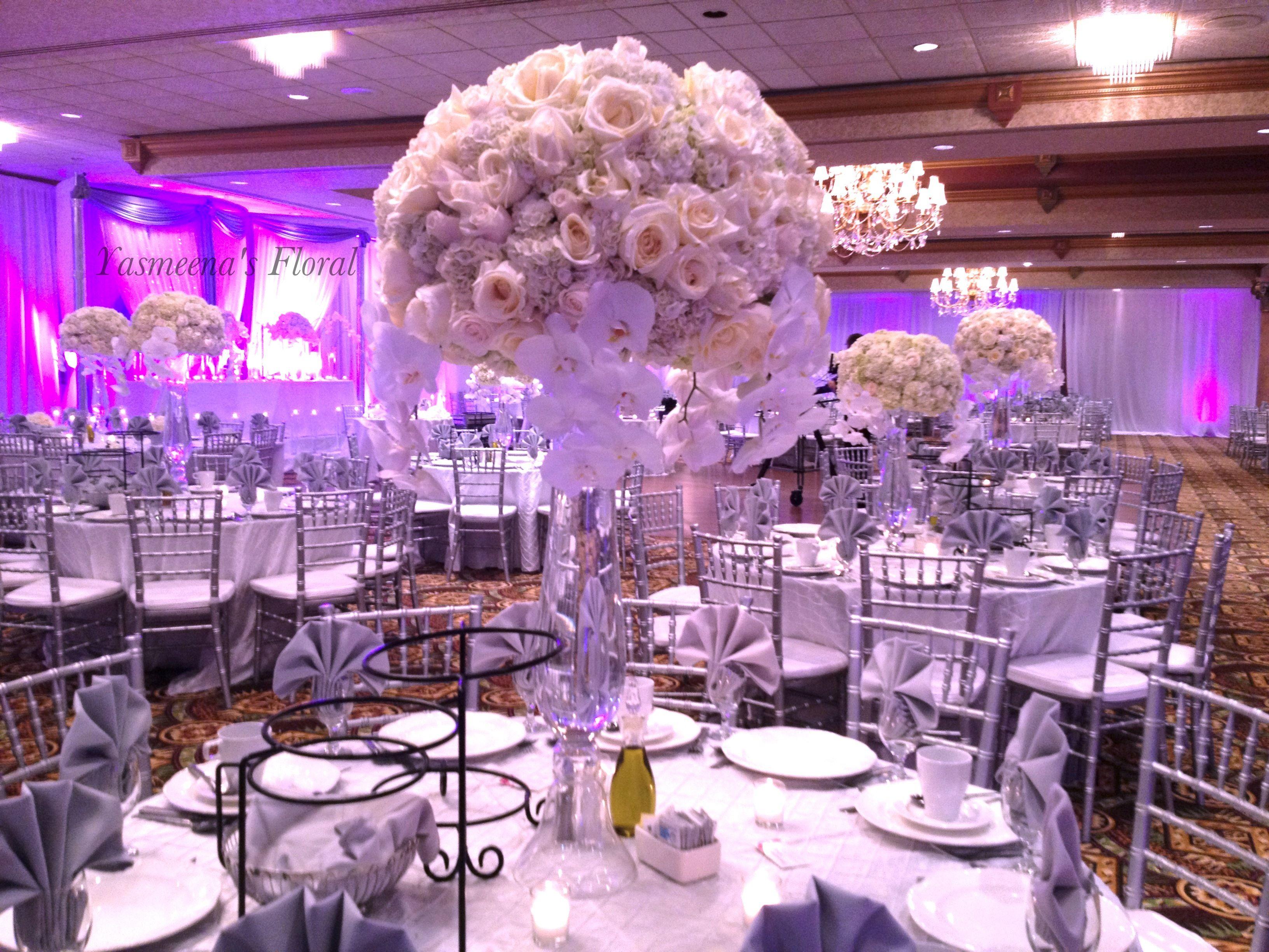 Yasmeena s Floral White floral centerpiece silver chiavari