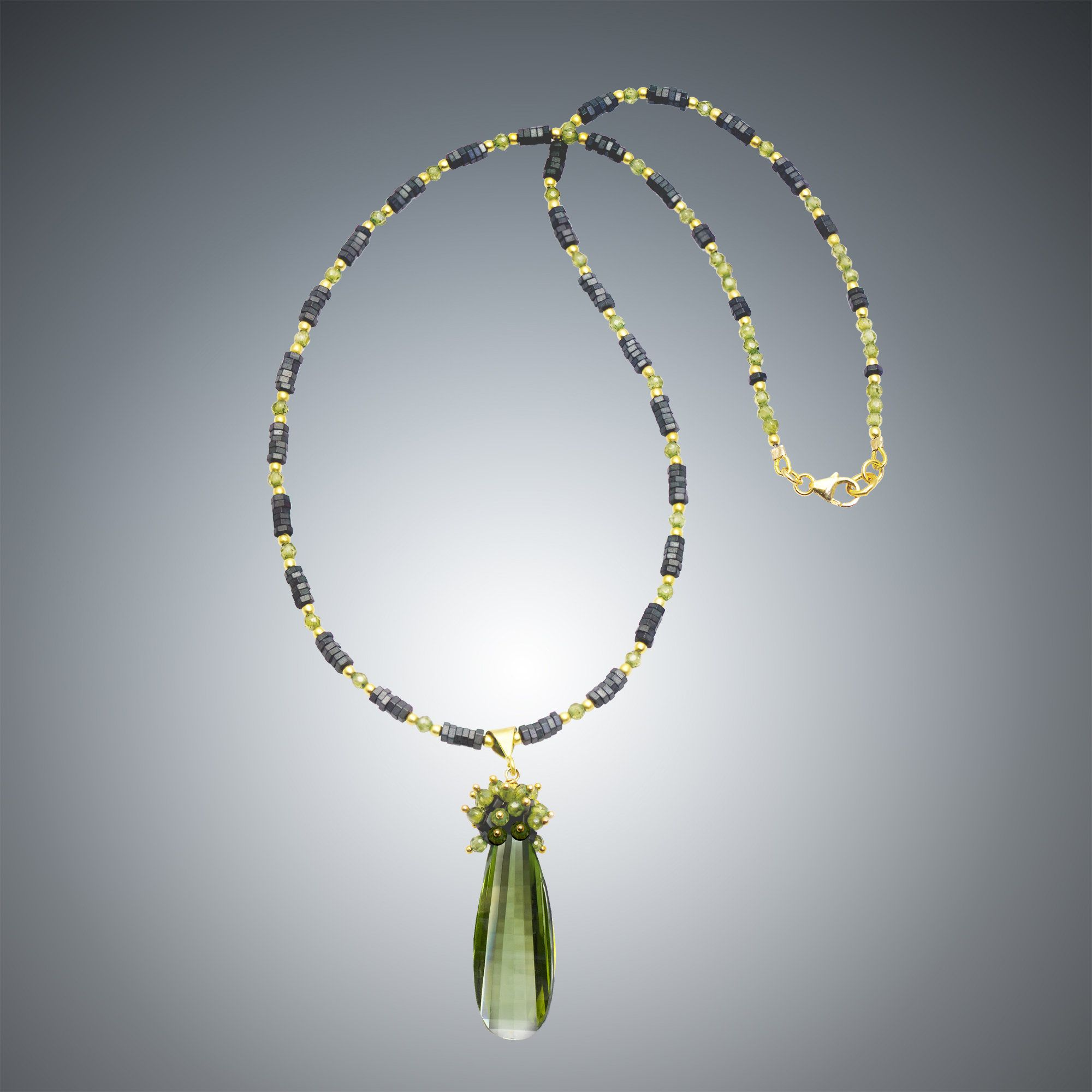 Green Quartz and Hematite Necklace by Judy Bliss. This necklace is combines faceted green quartz, hematite, and includes a vermeil trigger clasp.