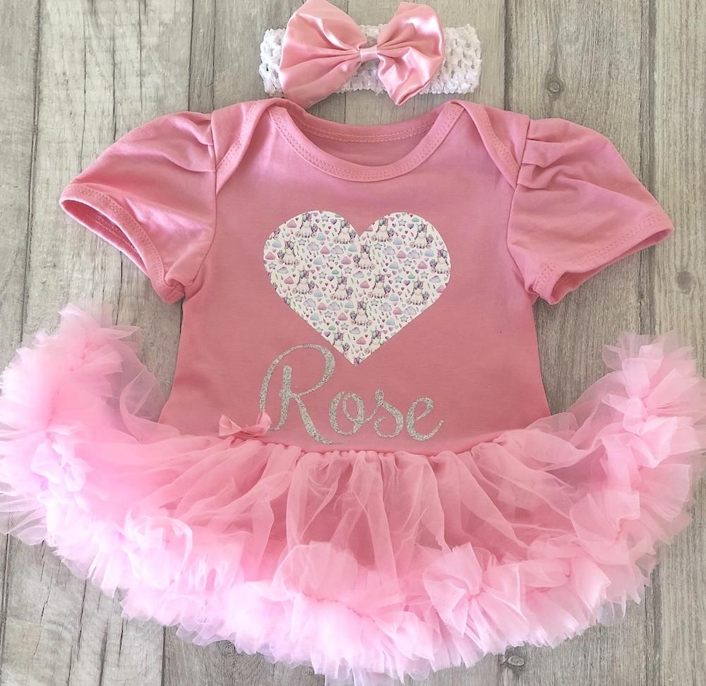 d660a7704b74 A gorgeous unicorn print with glitter text. A cute little outfit which  would make the perfect outfit for any newborn or little baby girl.