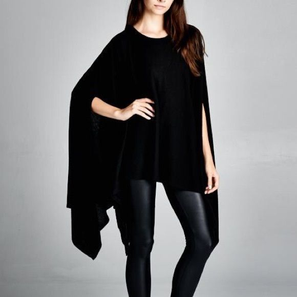 """""""Memento"""" Loose Poncho Tunic Top Loose fit, round neck asymmetrical hem poncho style tunic. Made with medium weight brushed fabric that has a soft fuzzy texture. Soft and drapes well. Similar to our """"contemporary"""" tunic but much warmer for cooler days. 67% polyester 29% rayon 4% spandex. One size fits most. Available in black and ivory. This listing is for the BLACK. Bare Anthology Tops Tees - Short Sleeve"""