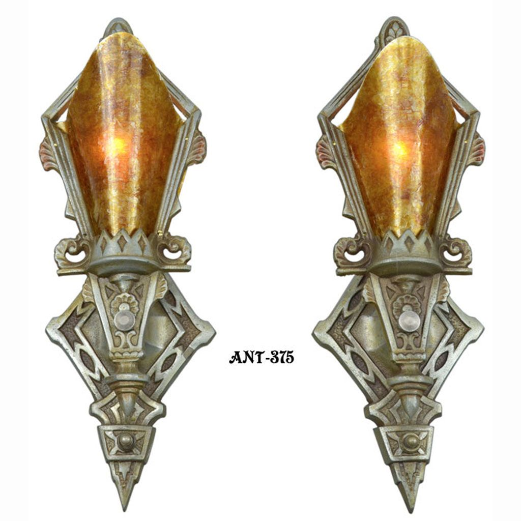 A truly unusual pair of art deco sconces probably made by lincoln