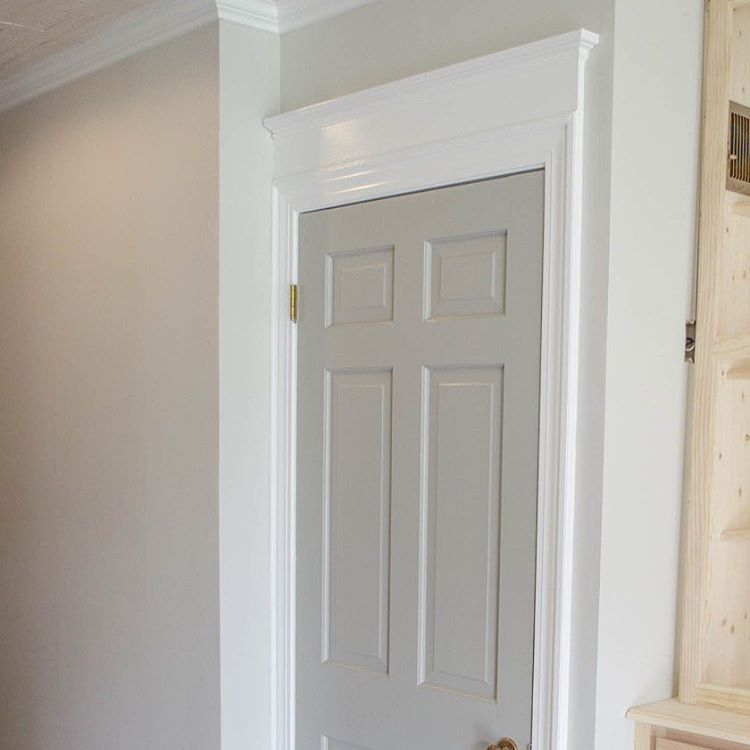 Adding height to doors with additional trim on top the wall color is sherwin williams agreeable Best white paint for interior doors