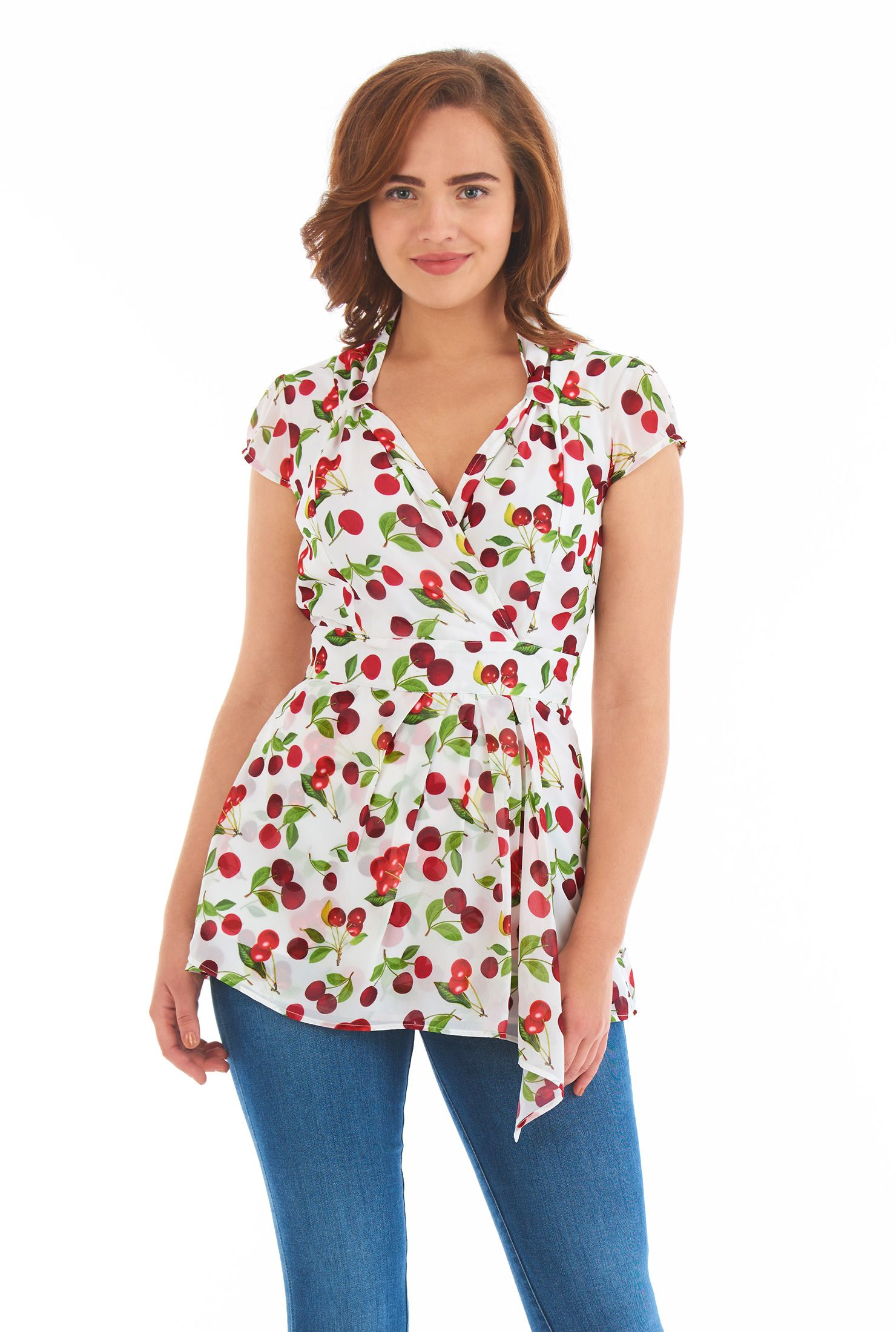 Our cherry print geor te top lets the draped hem with a feminine construction of the faux wrap stand out further