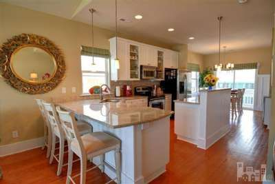 Open kitchen with granite countertops... cook dinner and watch the ocean waves! 1602 N Carolina Beach Ave 2 Carolina Beach, NC 28428 MLS# 491644  #coastalliving #beachhouse #vacation #dreamhouse #investment #kitchen
