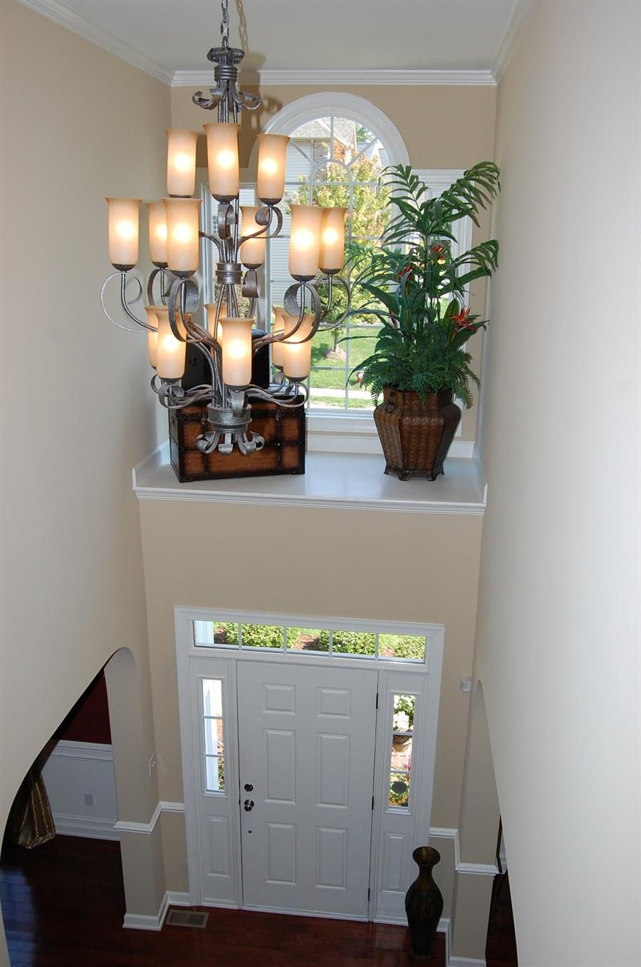 Two Story Foyer With Shelf Above Door With Window What