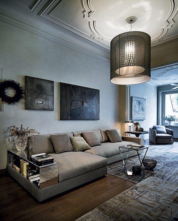 Wohnzimmer Möbel-Graues Polstersofa-Einbau Regale-Design Italienisch - Kuhfell Teppich Wohnzimmer
