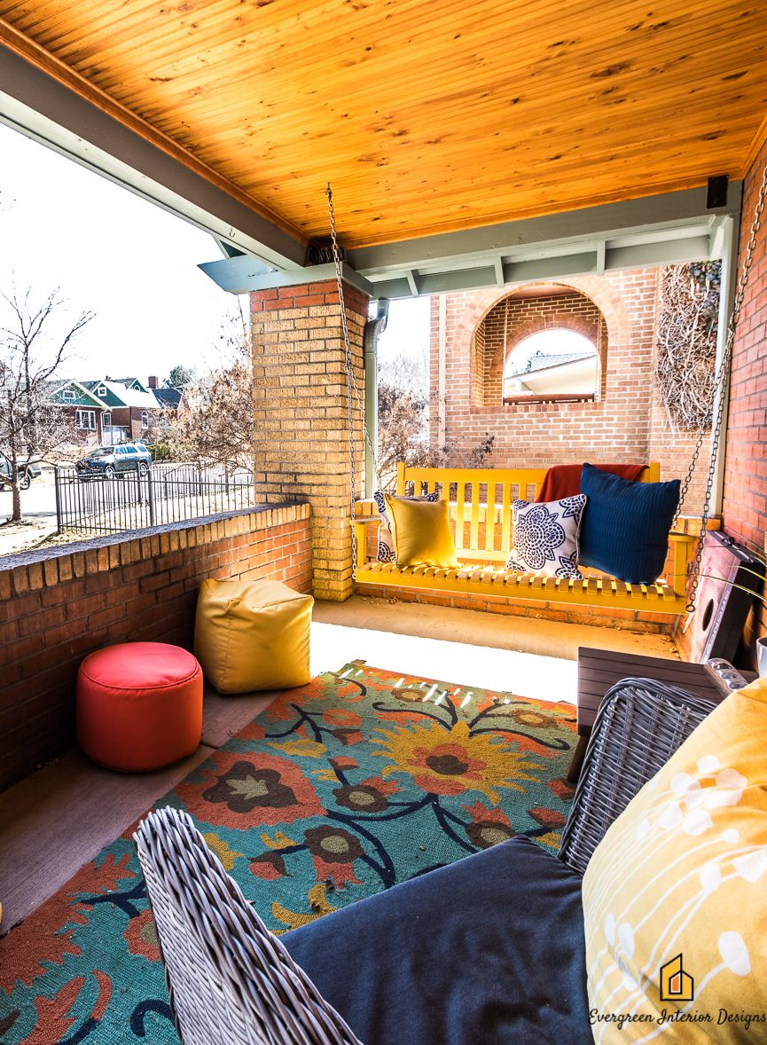 Evergreen interior designs front porch remodel bold and bright colors make this denver bungalow a fun and cheery place to hangout with friends and