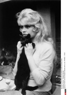 A black kitteh with Brigitte Bardot, early 1960s