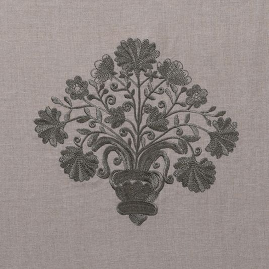Tuileries Fabric An embroidered curtain fabric featuring a medium scale basket of flowers motif inspired by the early 20th century Arts and Crafts movement in Massachusetts. Woven in pewter on a natural grey linen ground.