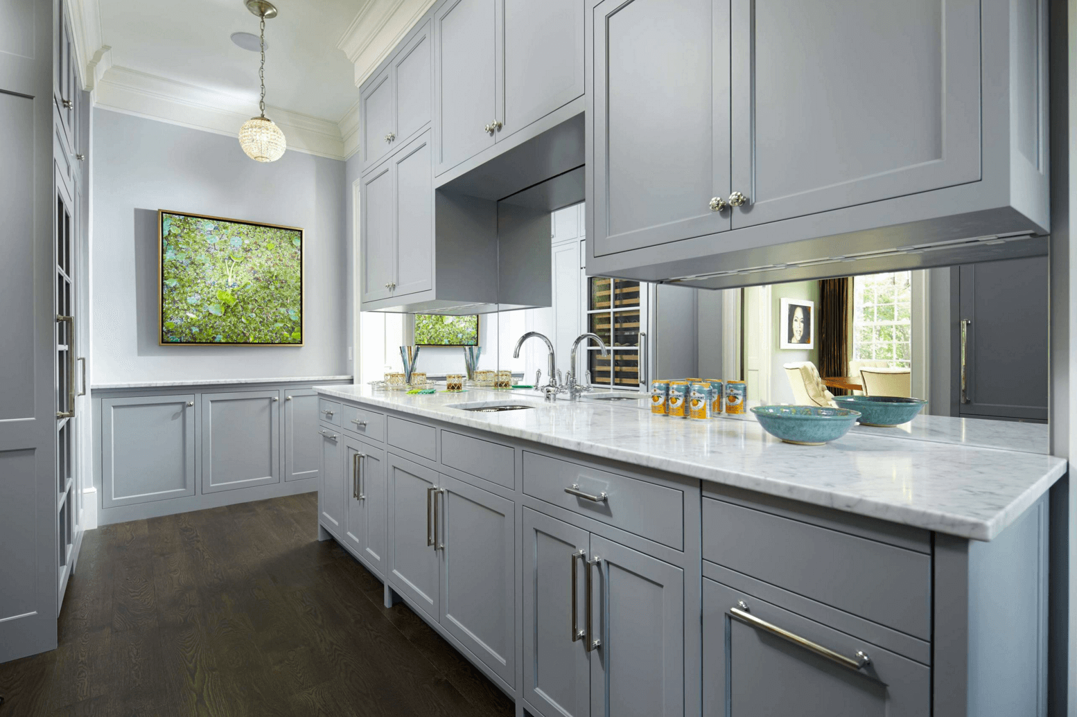 Gray Butlers Pantry Boasts Blue Paint On Upper Walls And Wainscoting Lower Alongside Shaker Cabinets Paired With White Marble
