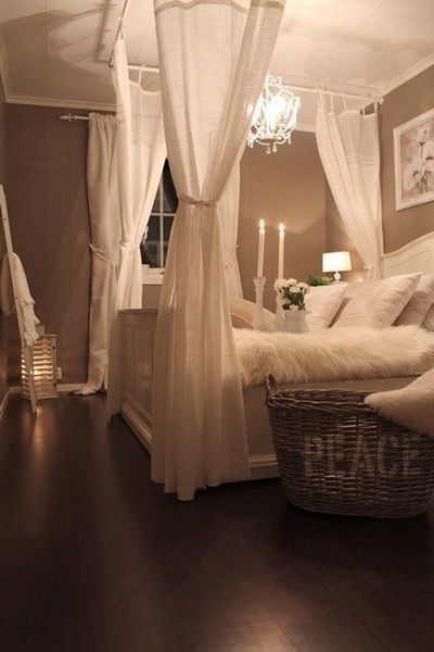 Curtain rods from ceiling create 4 poster bed.  This whole bedroom looks so peaceful :) What a great idea!