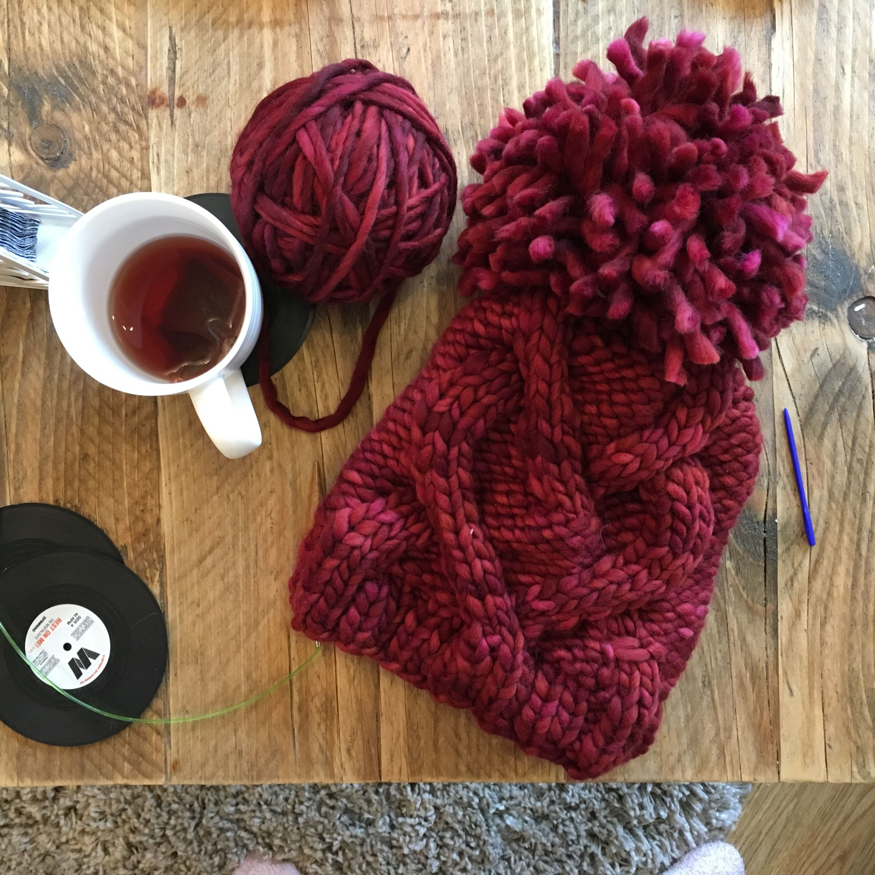 Red heart cable hat knitting project shared on the LoveKnitting Community.