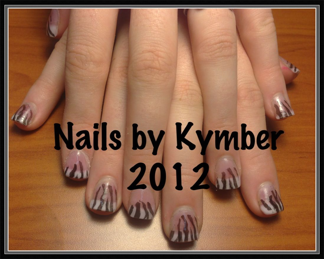Pink and white acrylics with basic zebra print over the top.