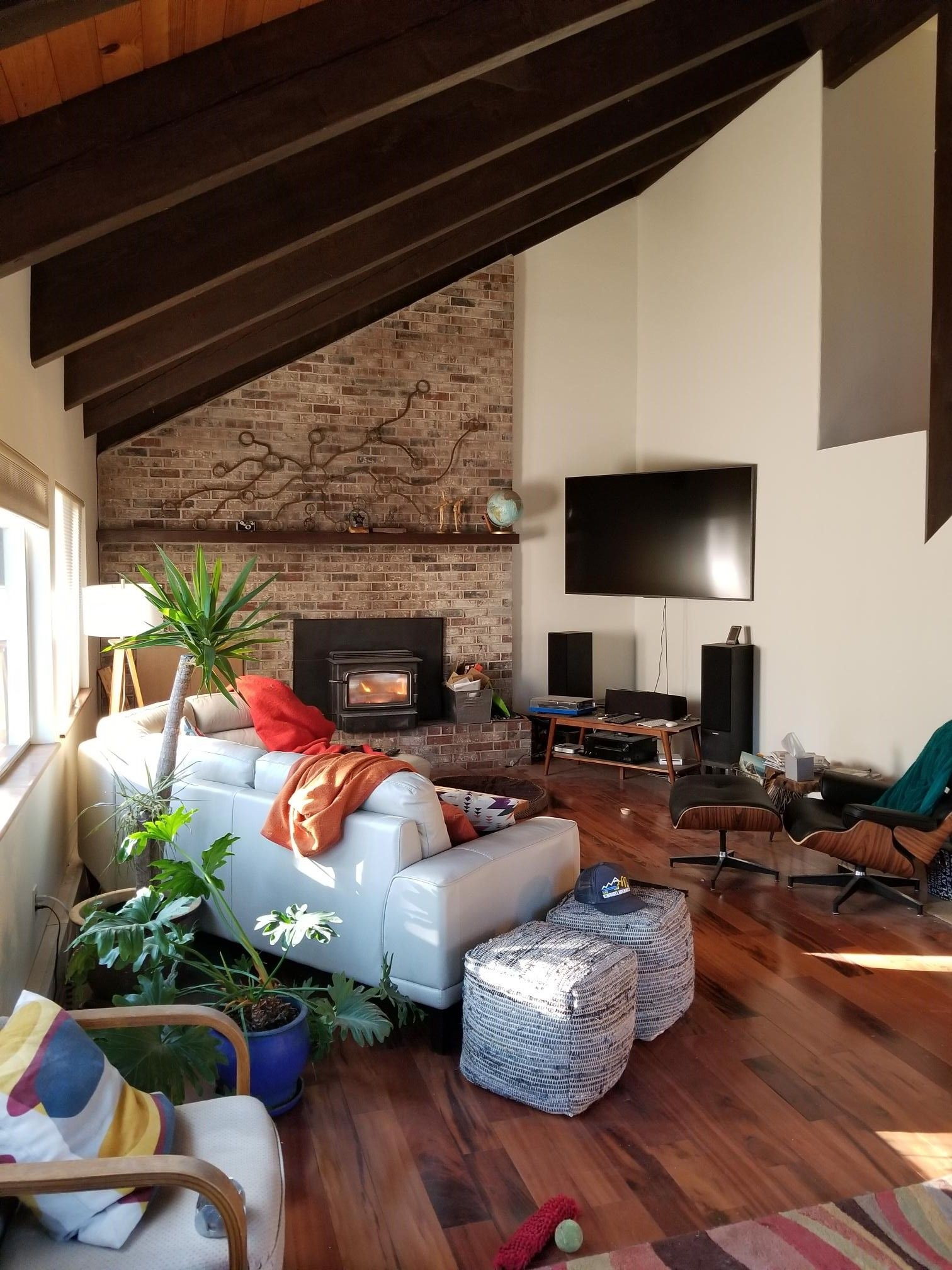 big oddly shaped living room - before | brown living room