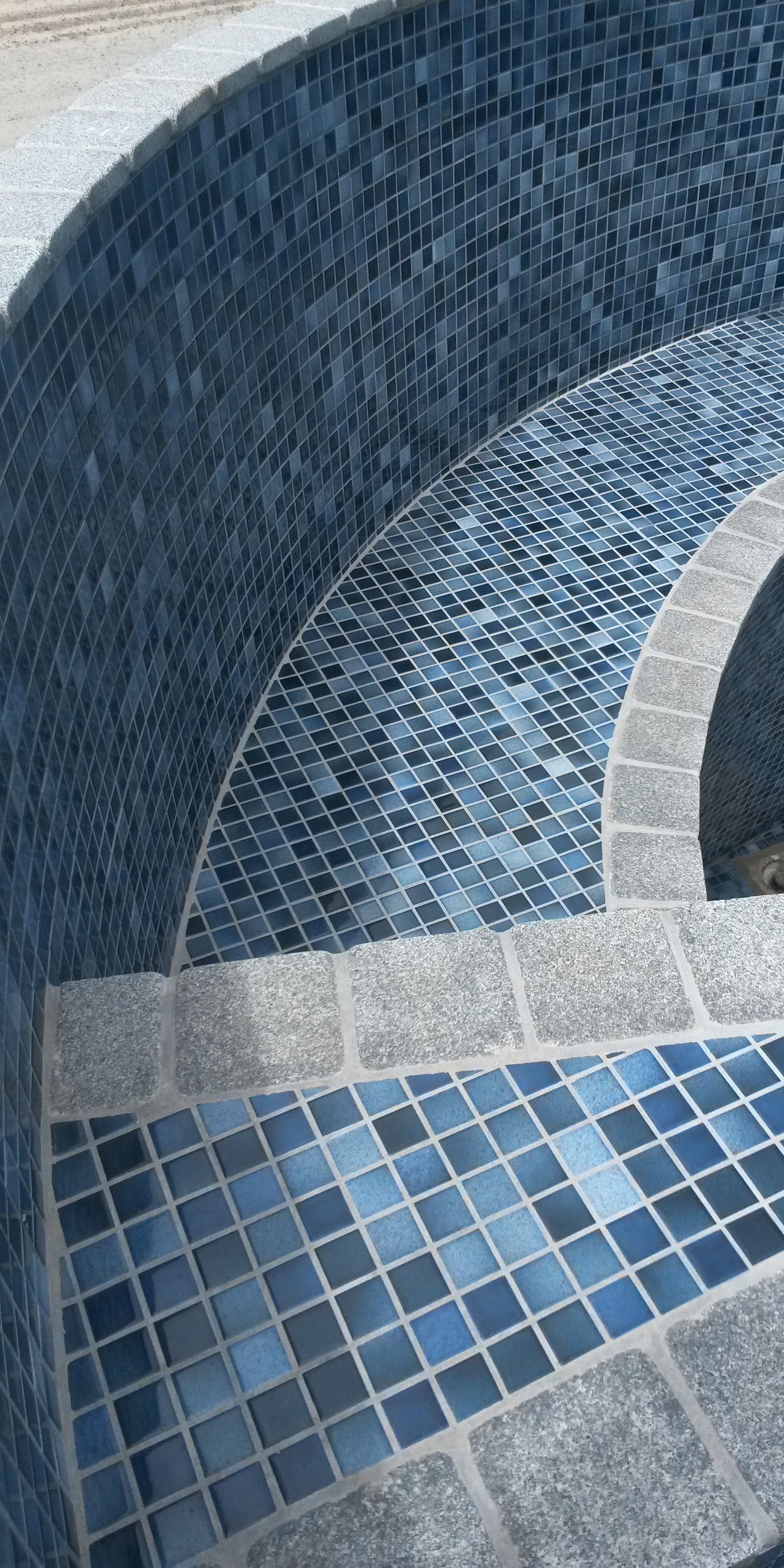 Bering Sea tiles. Mid grey granite edge. Fully tiled bench seat and step.
