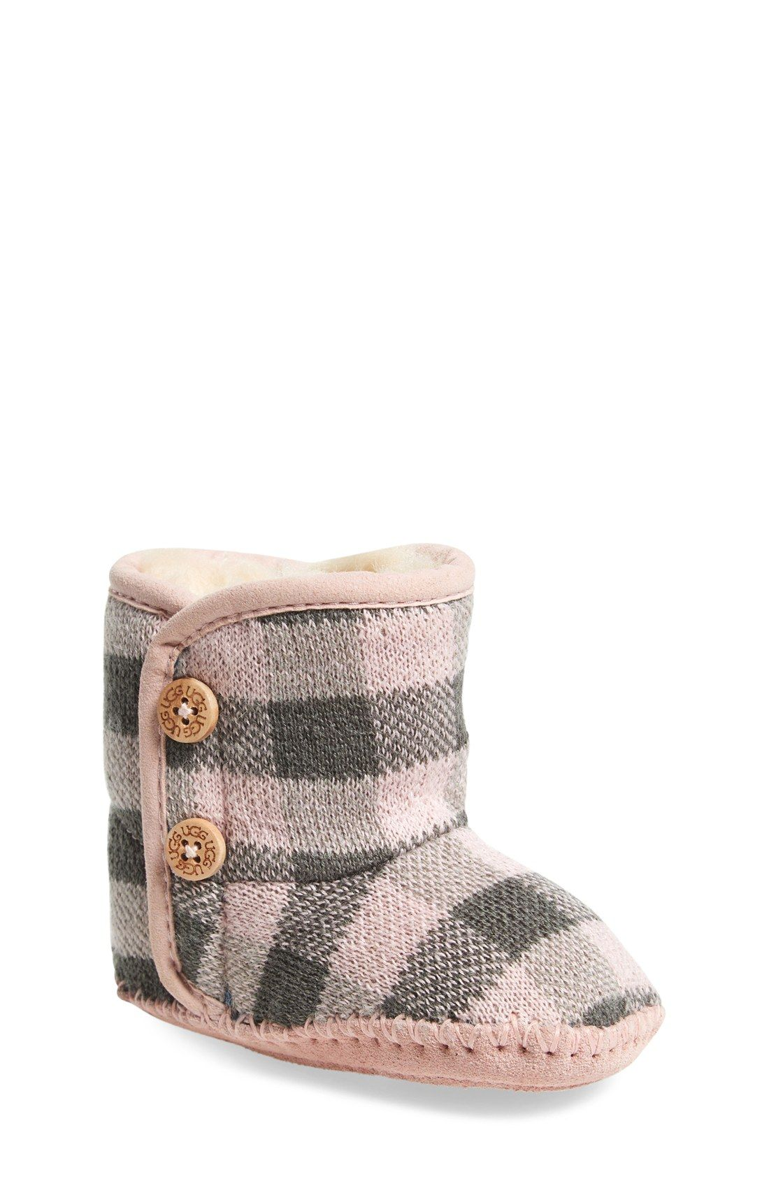Crushing on these baby UGG booties that are cozy and cute! The pink and grey plaid adds a fun pattern to these knit slippers with wood buttons.