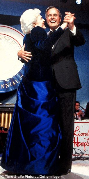 President George Bush and wife, Barbara - draped in a royal blue (her favorite color - dubbed 'Barbara Bush Blue') evening gown - dance on Jan. 20,1989 at the inaugural ball at the Pension Building in Washington.