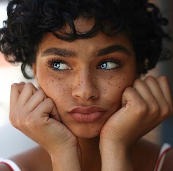 Dark Skin Dark Hair Freckles Curly Hair Face Rested On Hands