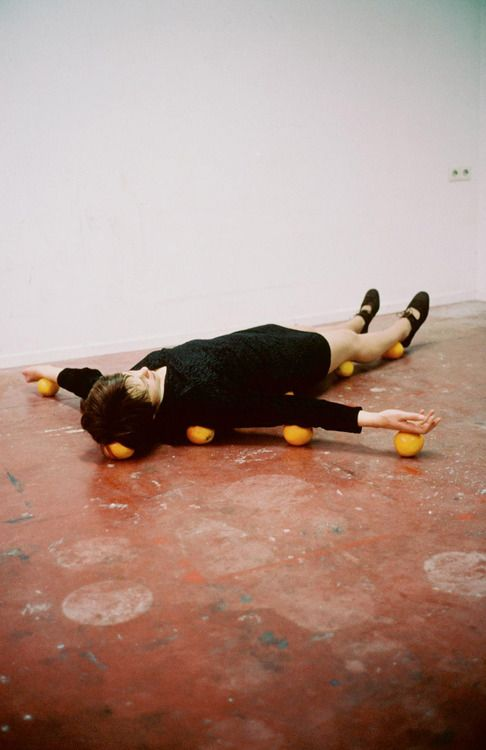 One Minute Sculpture by Erwin Wurm. Methinks it would have had more impact if she was lying on tomatoes. (0: