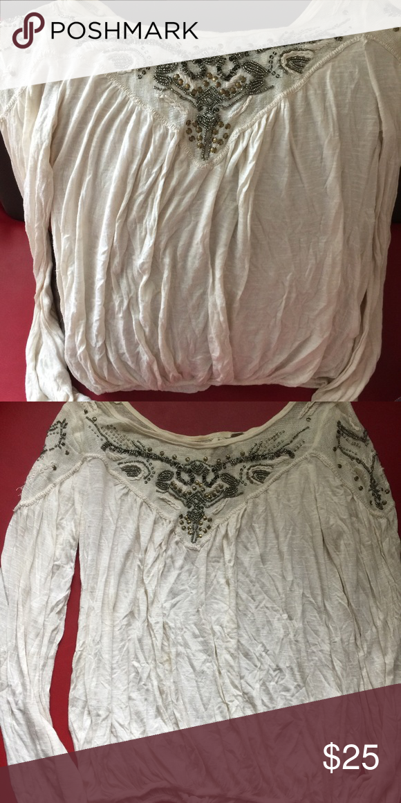Free people blouse sz xs Free people blouse ivory color with beads around the collar sz xs . Pet & smoke free home Free People Tops Blouses