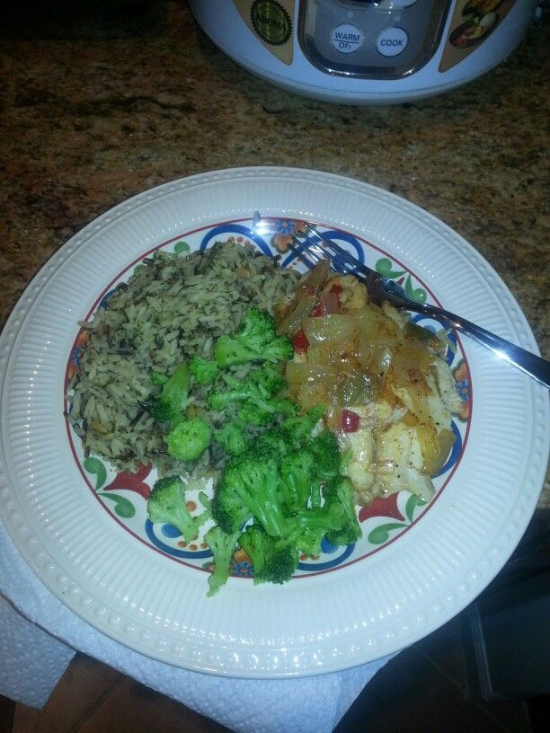 Some good eating! Tilapia with onions and peppers,  broccoli,  and wild rice.