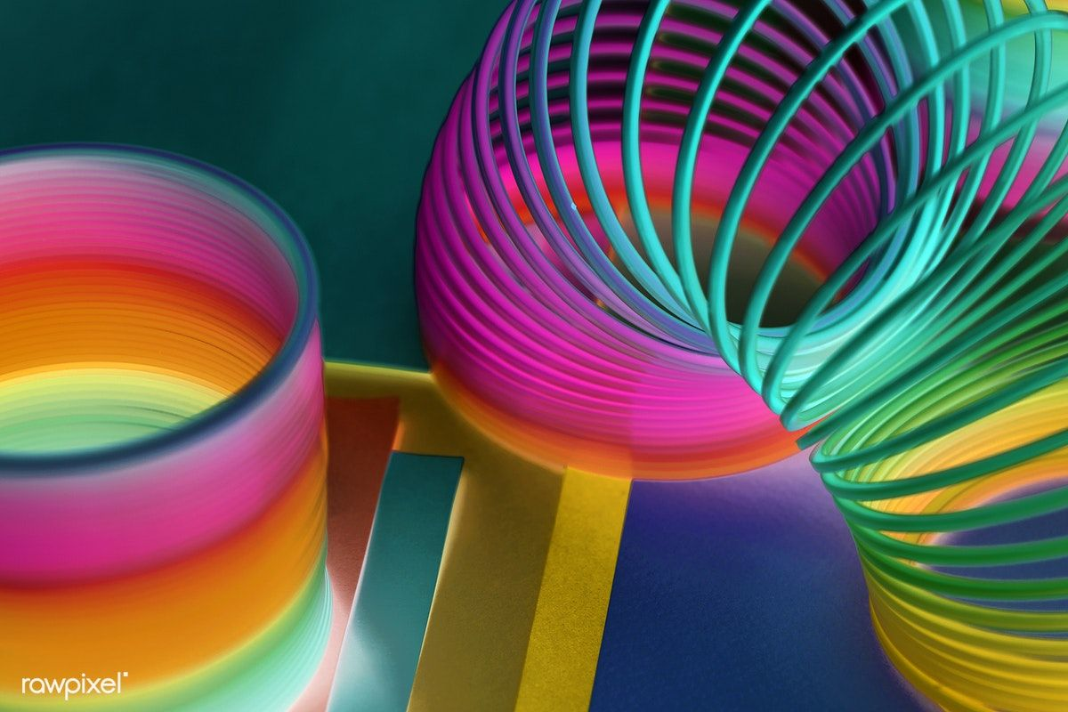 Closeup of rainbow spring toy background free image by