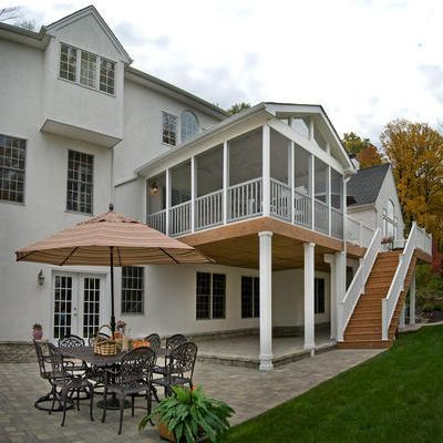 Elevated deck with stairs and screened porch design for Elevated house plans with porches