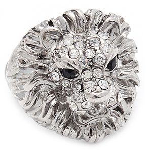 "This stretch ring is adjustable to fit most ladies. The fashion ring has an antique look, shaped like a lion's head and is adorned with crystal studs. The ring is metal casting. Size: 1"" Tall - Color: Clear   $17.99"
