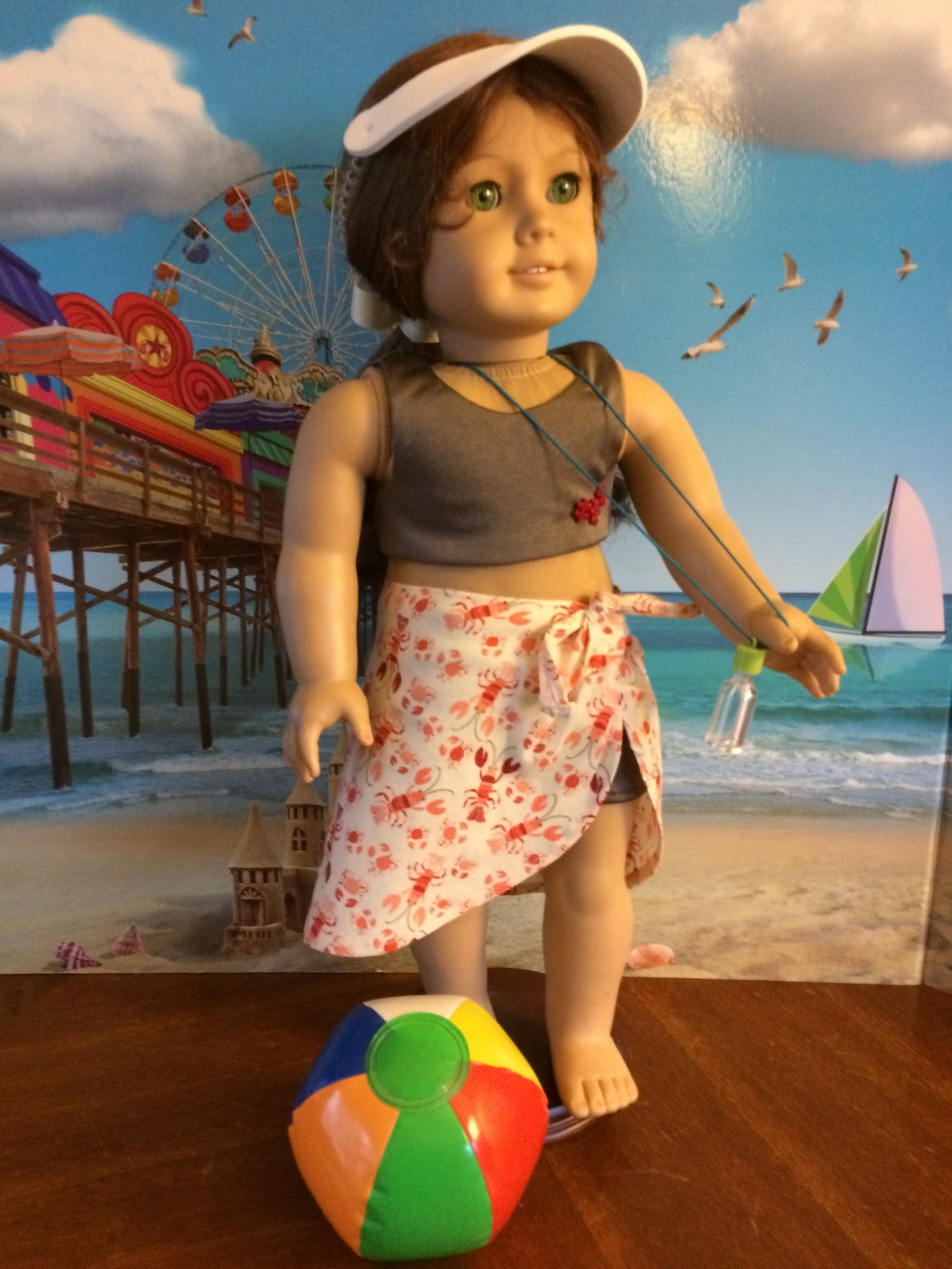 "8601cc6760 18""doll outfit includes two piece bathing suit, cotton sarong, visor,  message in a bottle necklace, beach ball. *doll not included."