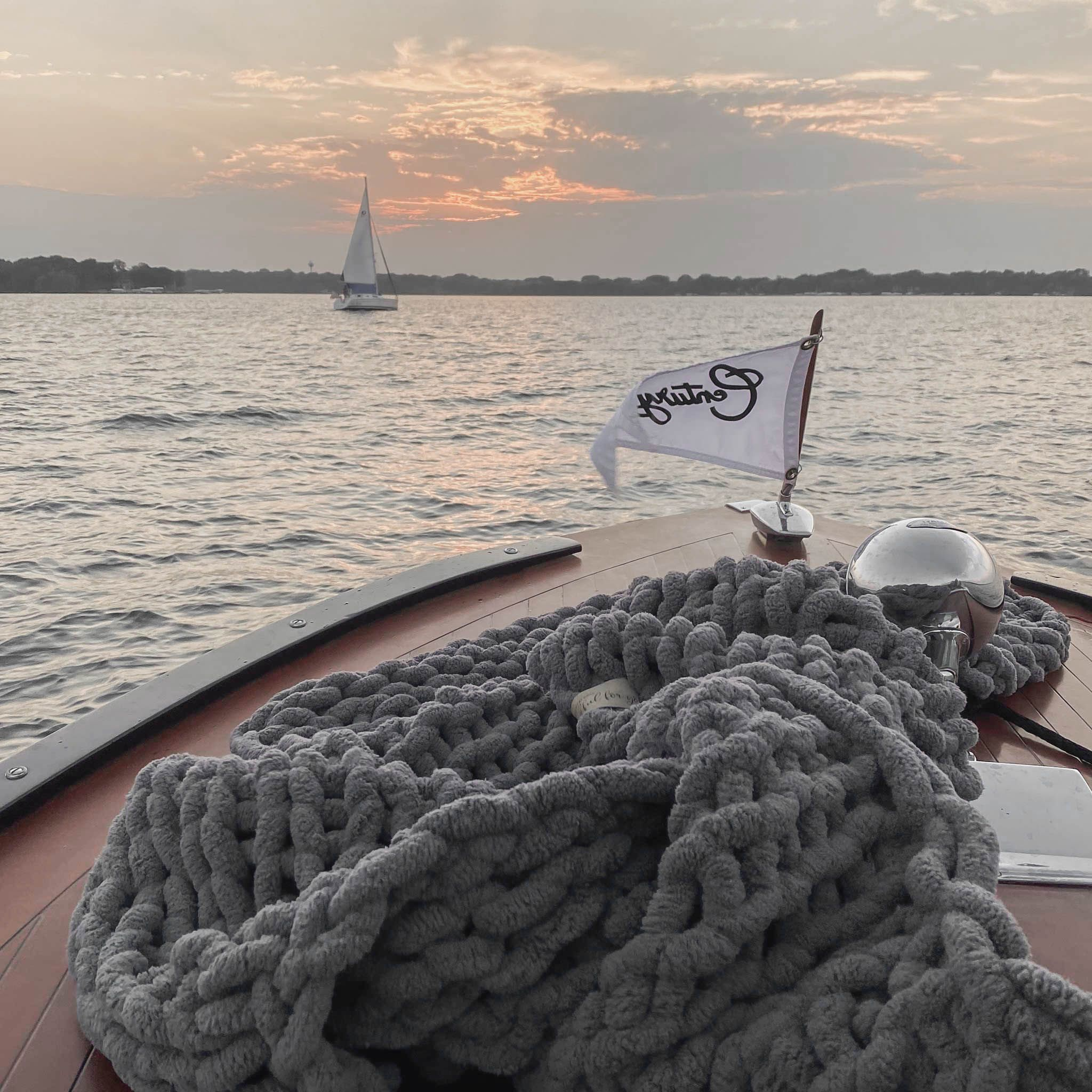 As summer sails into the sunset ~ . . . #biglovie  #blankets #love #spreadthelove #wrapupinlove #happy #life #positivevibes #givelove #inspiration #endofsummer #lakelife #okoboji #boating #woodenboats #chunkyknitblanket #infinitelove #cozy #bestgifts #weekend #relax