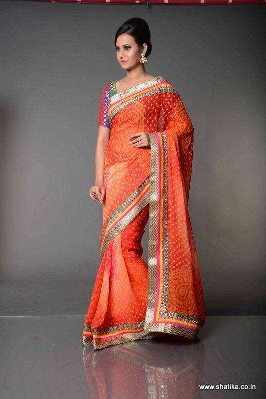 60490bff16 Amanpreet Mirror Work Bordered Pure Bandhej Saree: The dazzling and vibrant  Amanpreet Thread Work Bordered Bandhej Saree is an endowment of pure Bandhej  ...