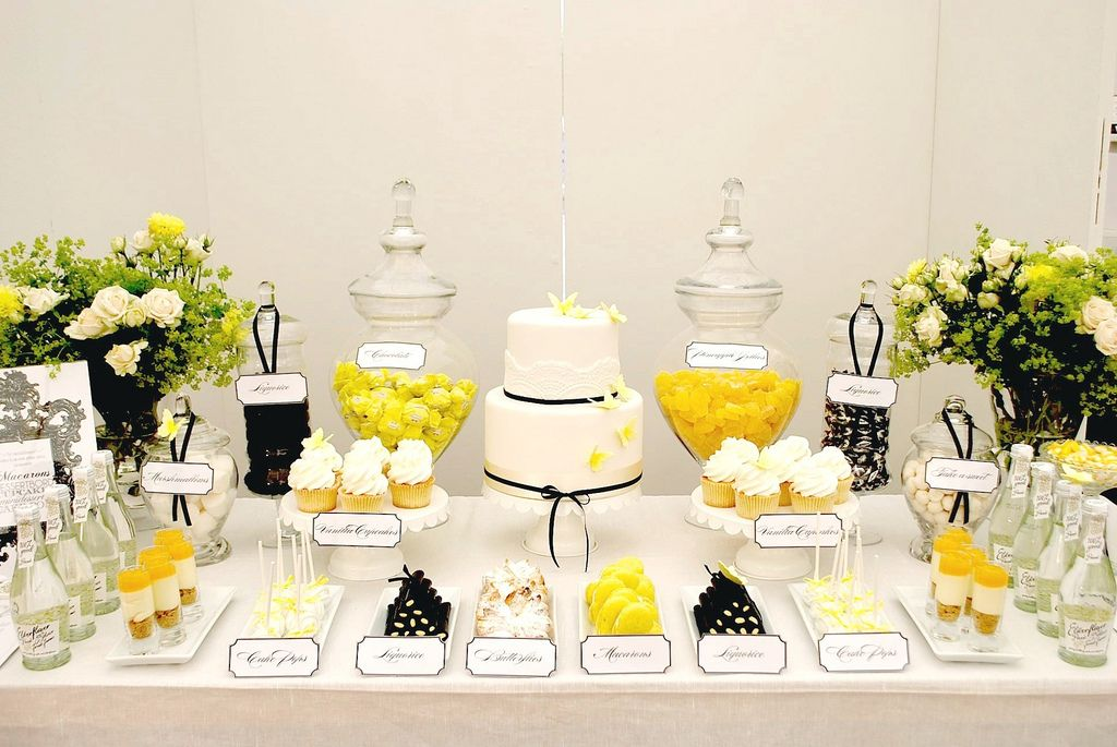 yellow black white dessert table