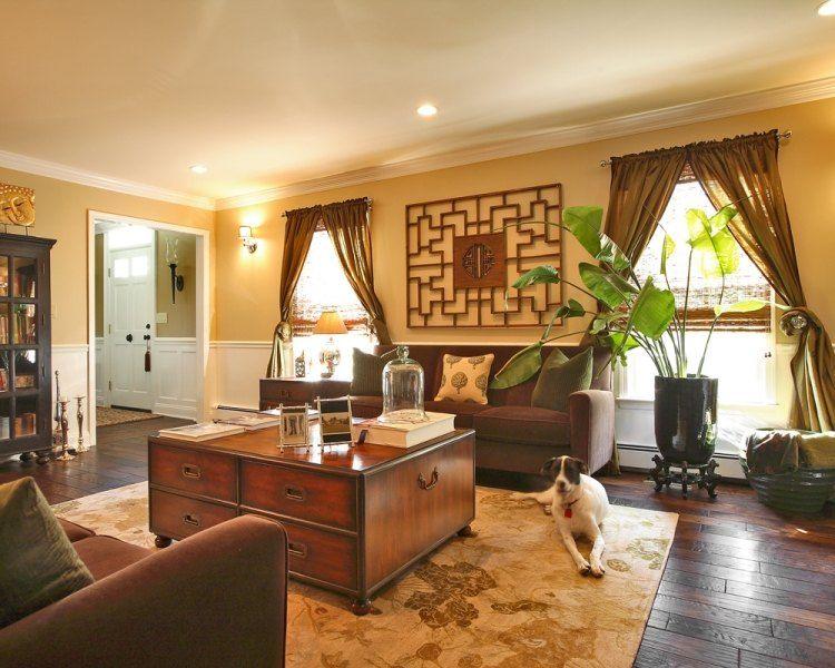 Wohnzimmer in Braun mit orientalischen Elementen des Interieurs - wohnzimmer orange braun