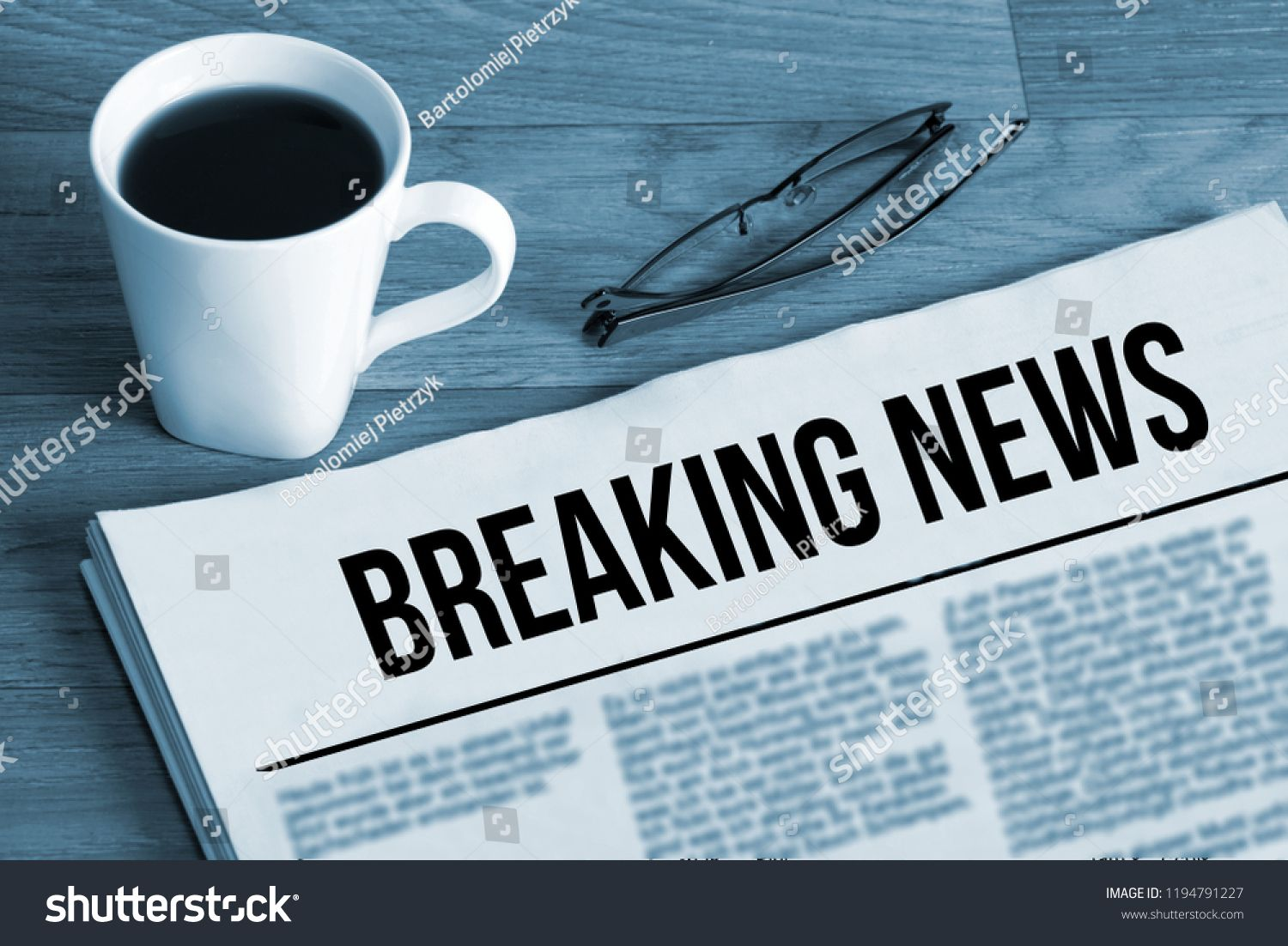 A cup of coffee and newspaper titled Breaking
