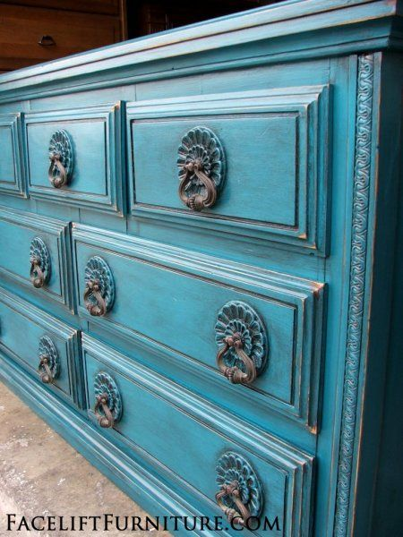 Ornate Dresser in distressed Peacock Blue with Black Glaze. Original pulls. From Facelift Furniture's DIY Blog.