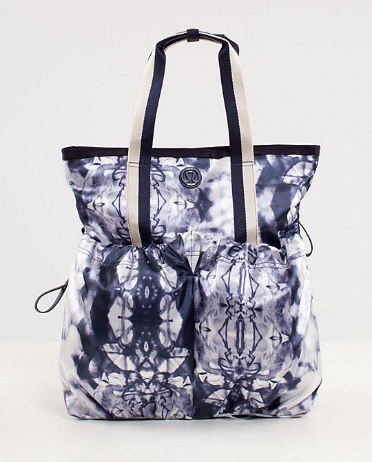9c4fecb6517 I love this funky carryall tote bag from Lululemon. This beauty can carry  up to 40 lbs and has loads of pockets and zippers for smaller items such as  keys, ...