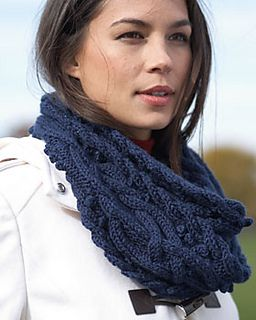 Bundle up in this elegant cable cowl for a stylish take on winter wear. Shown in Bernat Satin Sparkle.