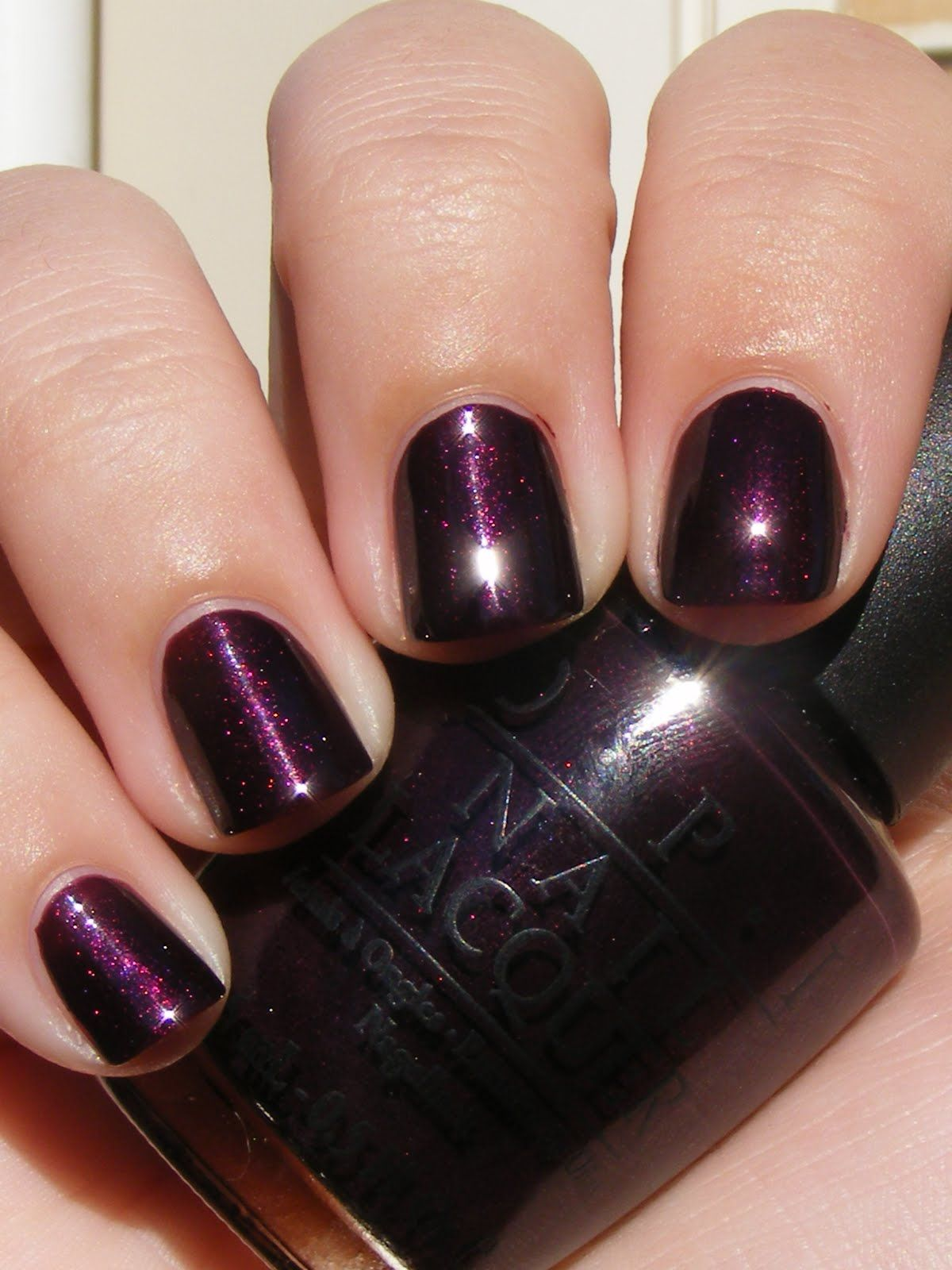 OPI- Black Cherry Chutney ♥ MY FAVE OPI color! Looks almost black indoors,  but when the light or sun shines on your nails that's when it sparkles!