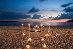 Risultati immagini per romantic dinner on the beach  300x200